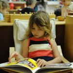 My girl enjoying a book at her Montessori preschool