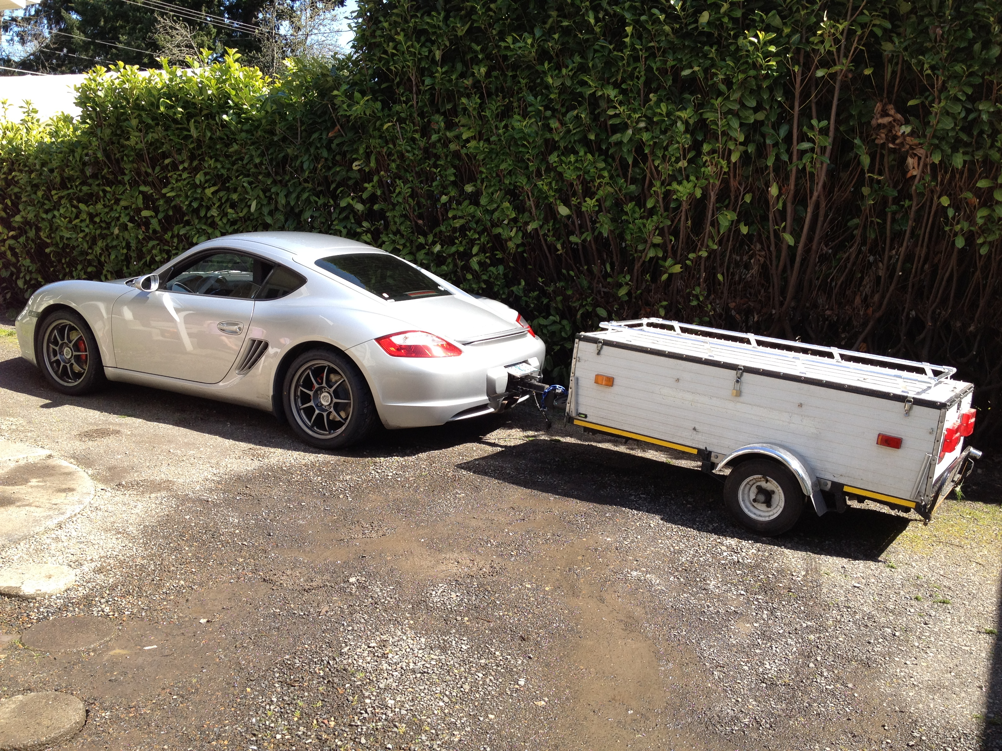 Ever seen a Porsche tow a camping trailer? Well, now you have!